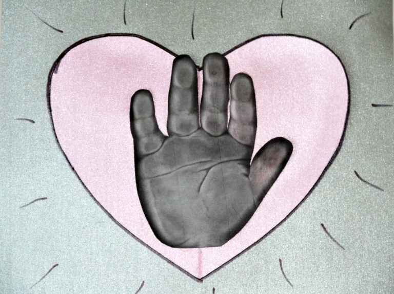 Handprint in heart